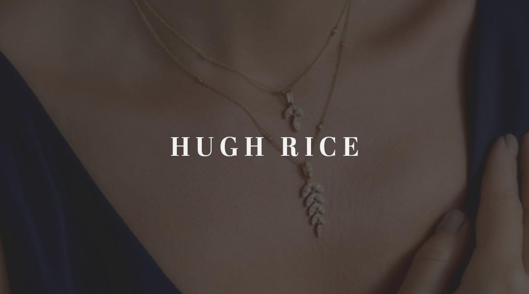 A close up of a Hugh Rice pendant with text Hugh Rice