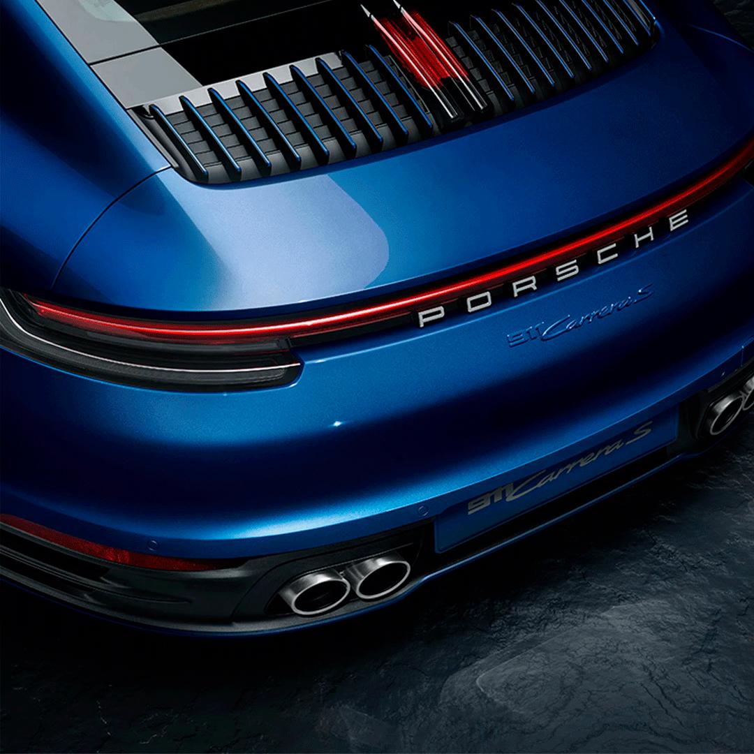 the rear bumper of a porsche nine eleven sports car in blue