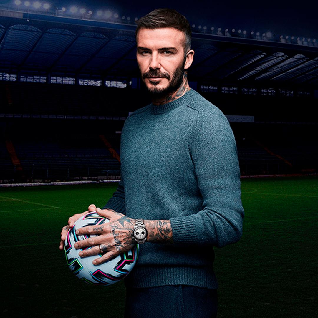 David Beckham holding a football